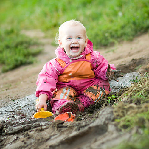 Baby With Mud Stains On Clothes