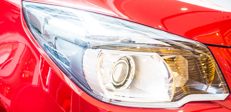 Close Up Of Red Car Headlight