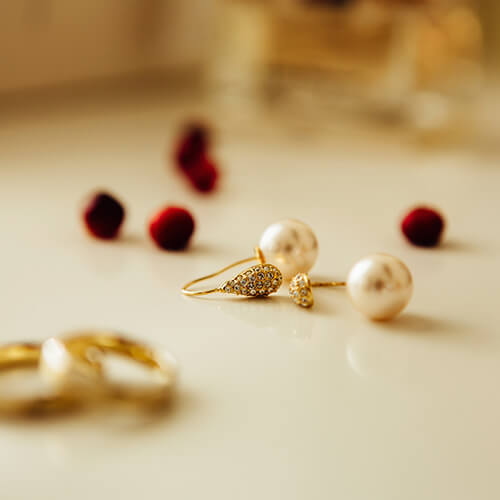 Gold Earrings on Dressing Table