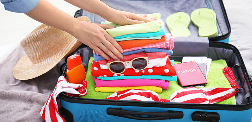 Person-Packing-A-Holiday-Suitcase