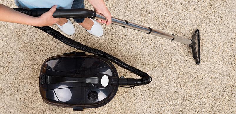 Person Vacuuming Cream Carpet