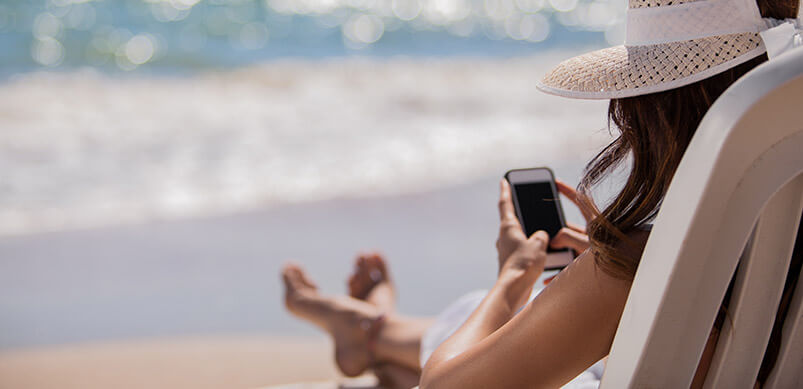 Woman On Phone On The Beach