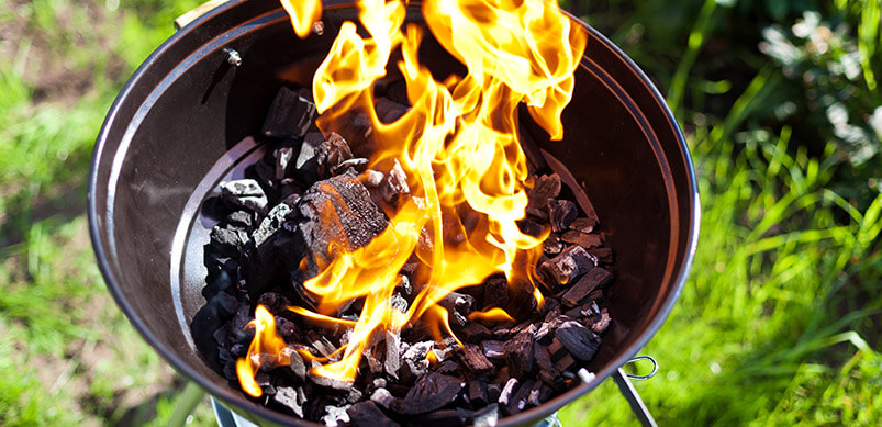 Barbecue With Charcoal On Fire