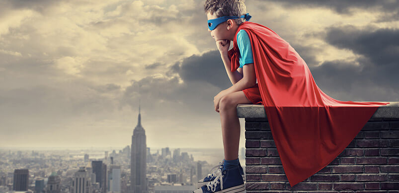 Boy Superhero Sitting On Roof