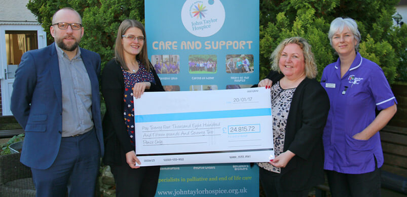 Caroline Giving Cheque To John Taylor Hospice