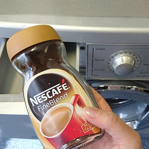 Coffee Held Over Washing Machine Drawer