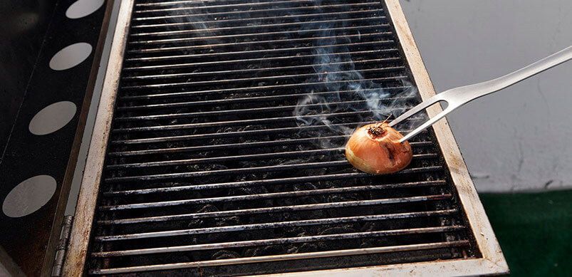 Cut Onion On BBQ Grill