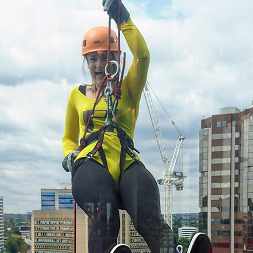 Eleanor Abseiling Down Glass