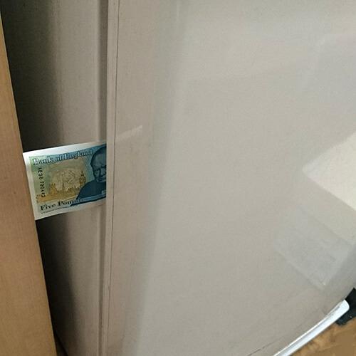 Fridge Door Seal Holding Five Pound Note