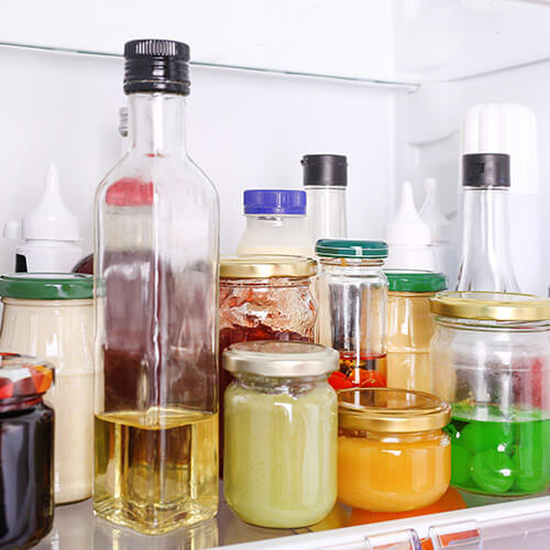 Jars And Condiments In Fridge