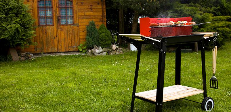 Lit BBQ In Garden