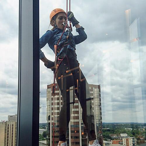 Mariya Abseiling Down Window