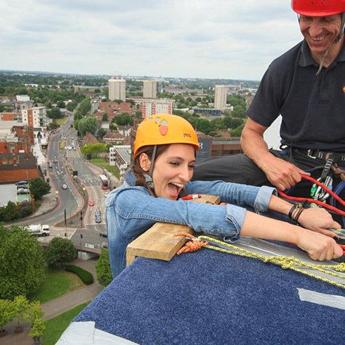 Mariya Hanging Over Building Looking Scared