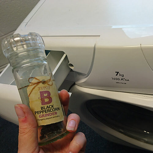 Pepper Held Over Washing Machine Drawer