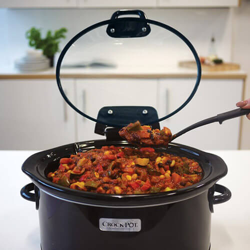 Person Dishing Food From Crockpot