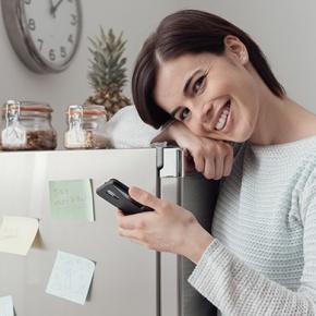 Smiling Woman Hugging Freezer