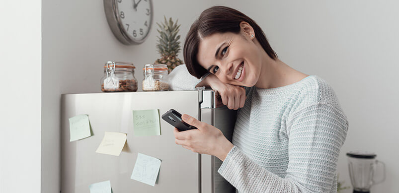Smiling Woman Hugging Freezer