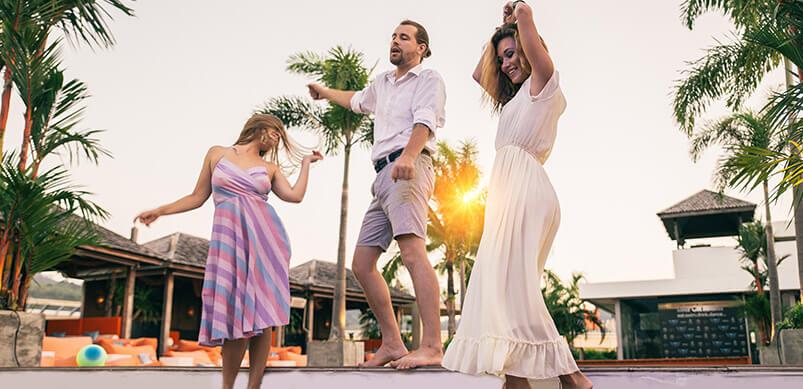 Three People Dancing Outside