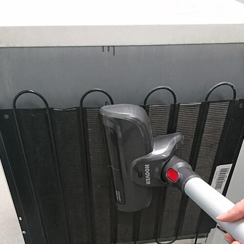 Vacuuming Fridge Condenser Coils