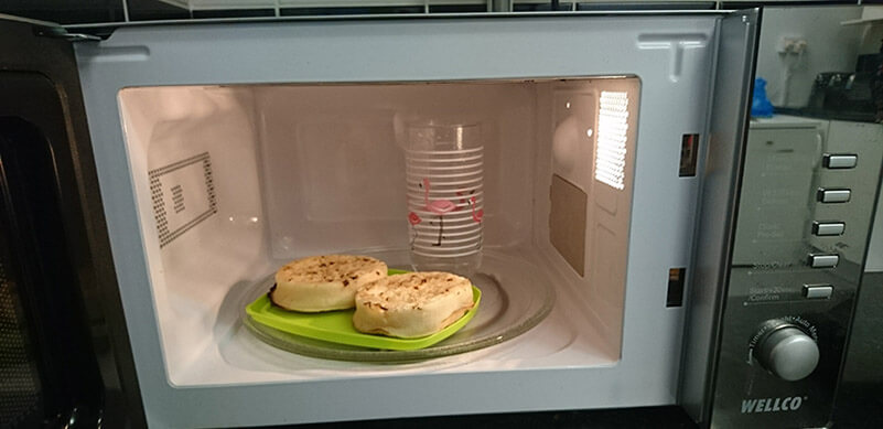 Crumpets In Microwave With Water In Glass