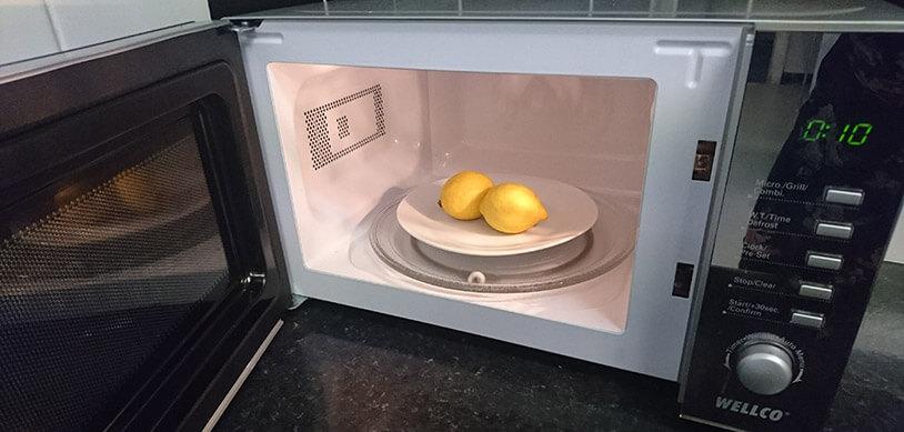 Lemons On Plate In Microwave