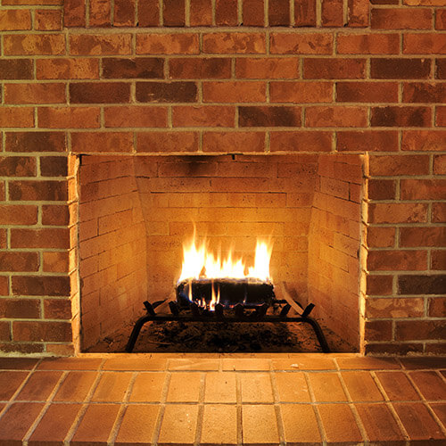 Brick Fireplace With Fire On