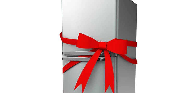 Silver Fridge With Red Bow Wrapped Around