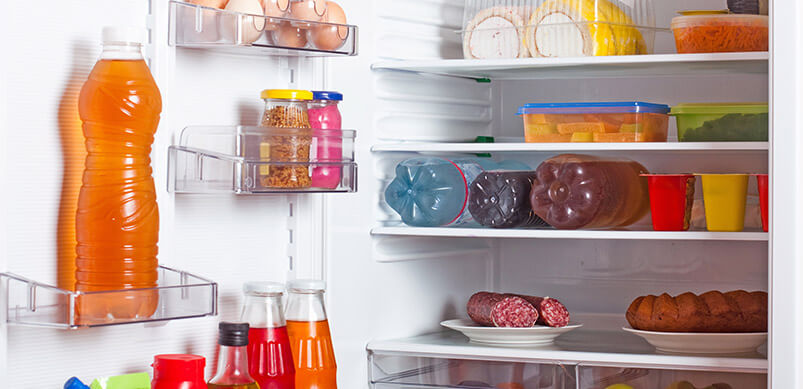 Refrigerator With Food Neatly Organised On Shelves