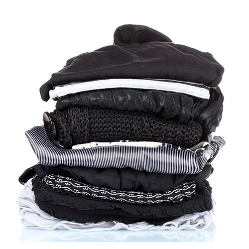 Pile of dark coloured clothes folded