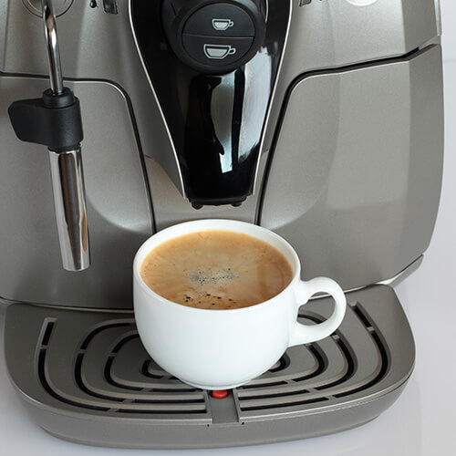 Coffee Machine With Full Cup Of Coffee