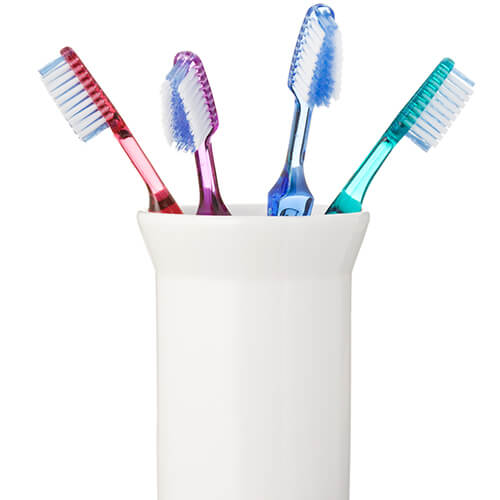 Coloured Toothbrushes In White Holder