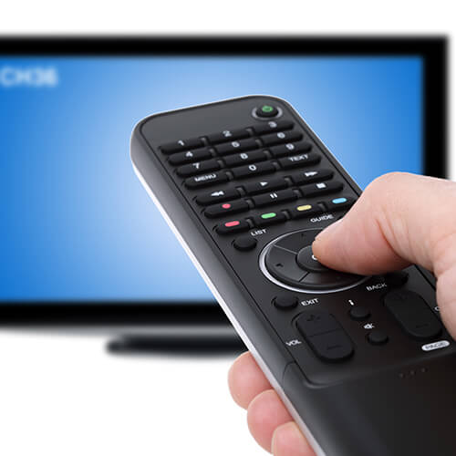 Hand Holding Remote Towards Television