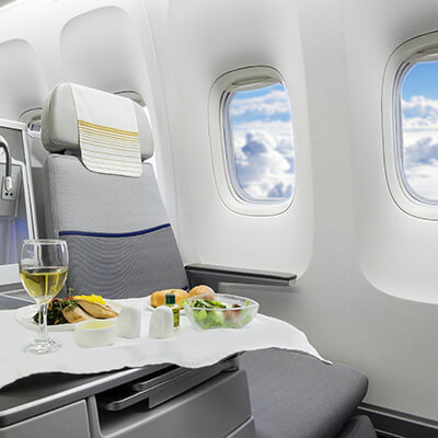 Comfy Aeroplane Seat With Food And Wine