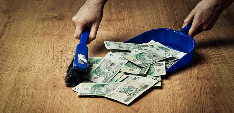 Sweeping Money With Dustpan And Brush