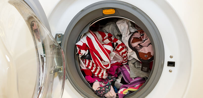 Washing Machine Full of Clothing