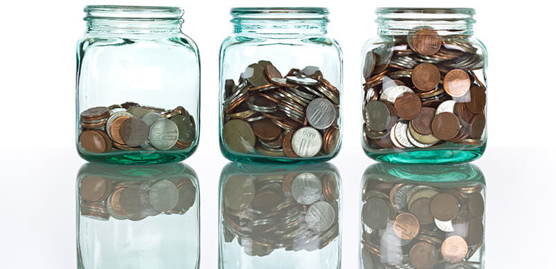 Three Glass Jars Filled With Coins