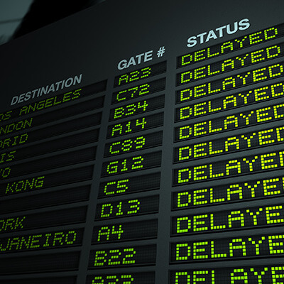 Airport Flight Information Board With Delayed Flights