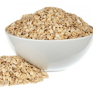 Rolled Oats In White Ceramic Bowl