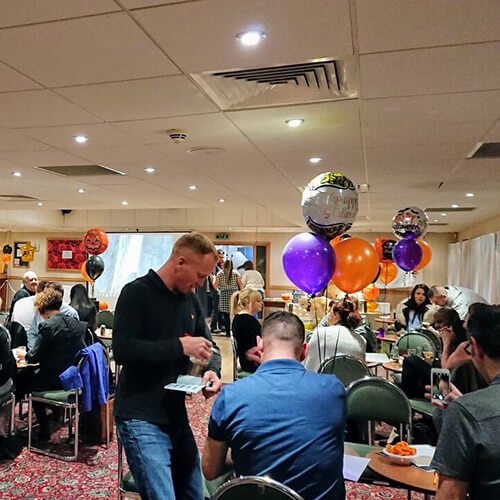 Tables Of People At Quiz Night