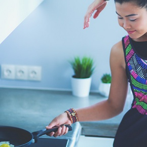 Woman Exercising Whilst Cooking Dinner