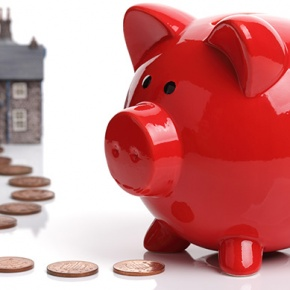 Red Piggy Bank With Change Leading to House