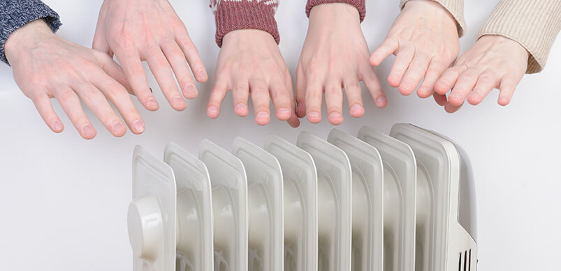 Hands Warming Over Electric Heater