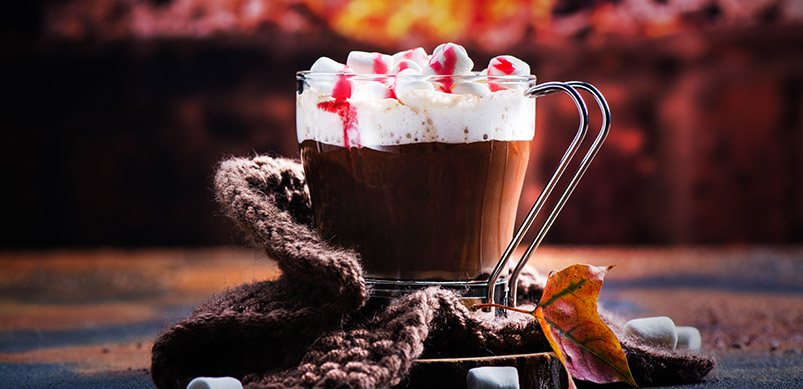 Hot Chocolate With Cream Next To Fireplace