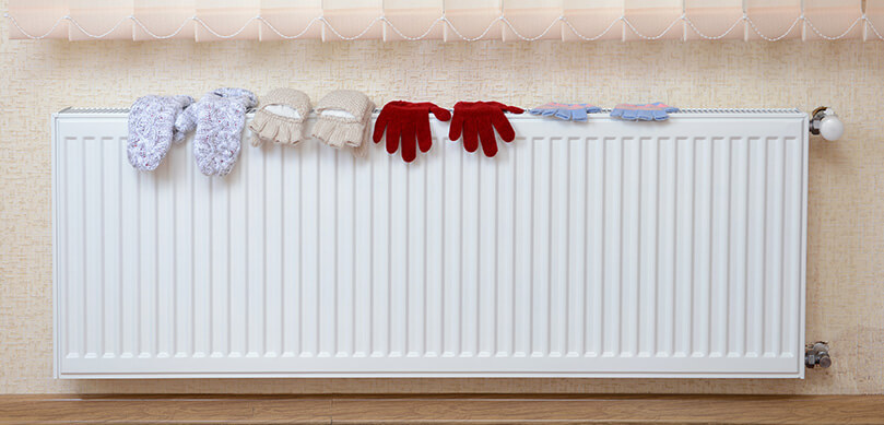 Knitted Gloves Drying On Radiator