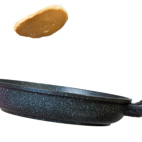 Frying Pan With Pancake Flipping In Air