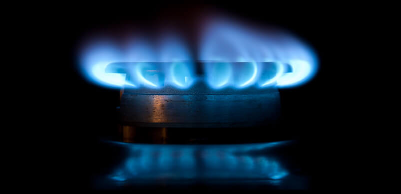 Gas Ring With Blue Flames On Black Background