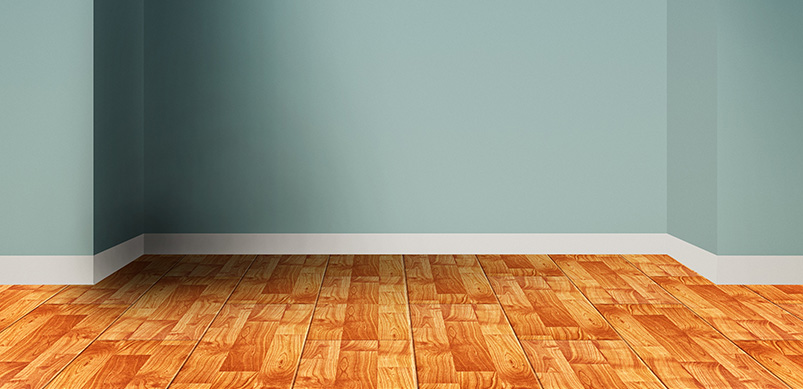 Wooden Floors Next To Blue Painted Wall