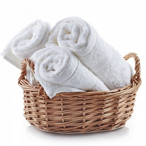 White Spa Towels In Wicker Basket