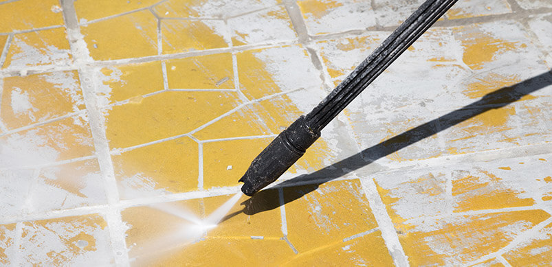 Pressure Washer Cleaning Outdoor Floor.