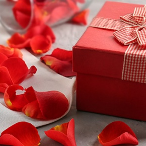 Red Gift Box With Scattered Red Rose Petals
